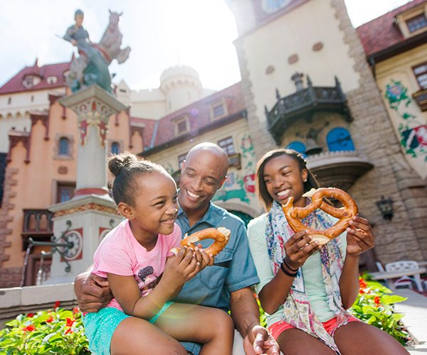 family eating pretzels at Dinsey's Epcot