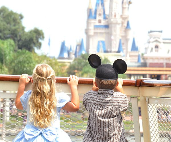 Kids looking at Disney Castle