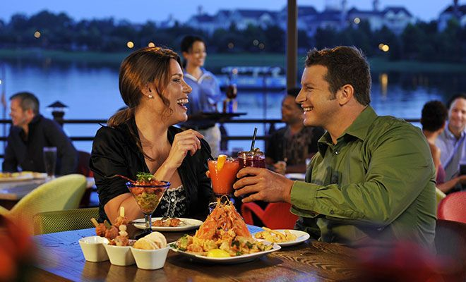 Couple dining and enjoying drinks at Paradiso 37 in Disney Springs