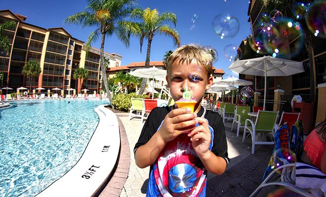 Kid blowing bubbles by the pool at Westgate Lakes Resort in Orlando